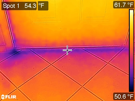 Thermal image of air leaking past damaged weather stripping.