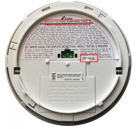 Location of model number and manufacture date on back side of Kidde smoke alarm.