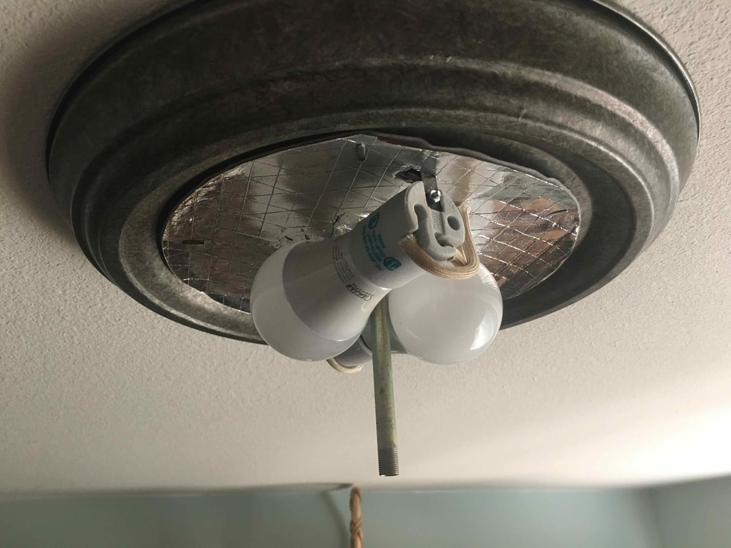 Light bulbs exposed after cover removal.