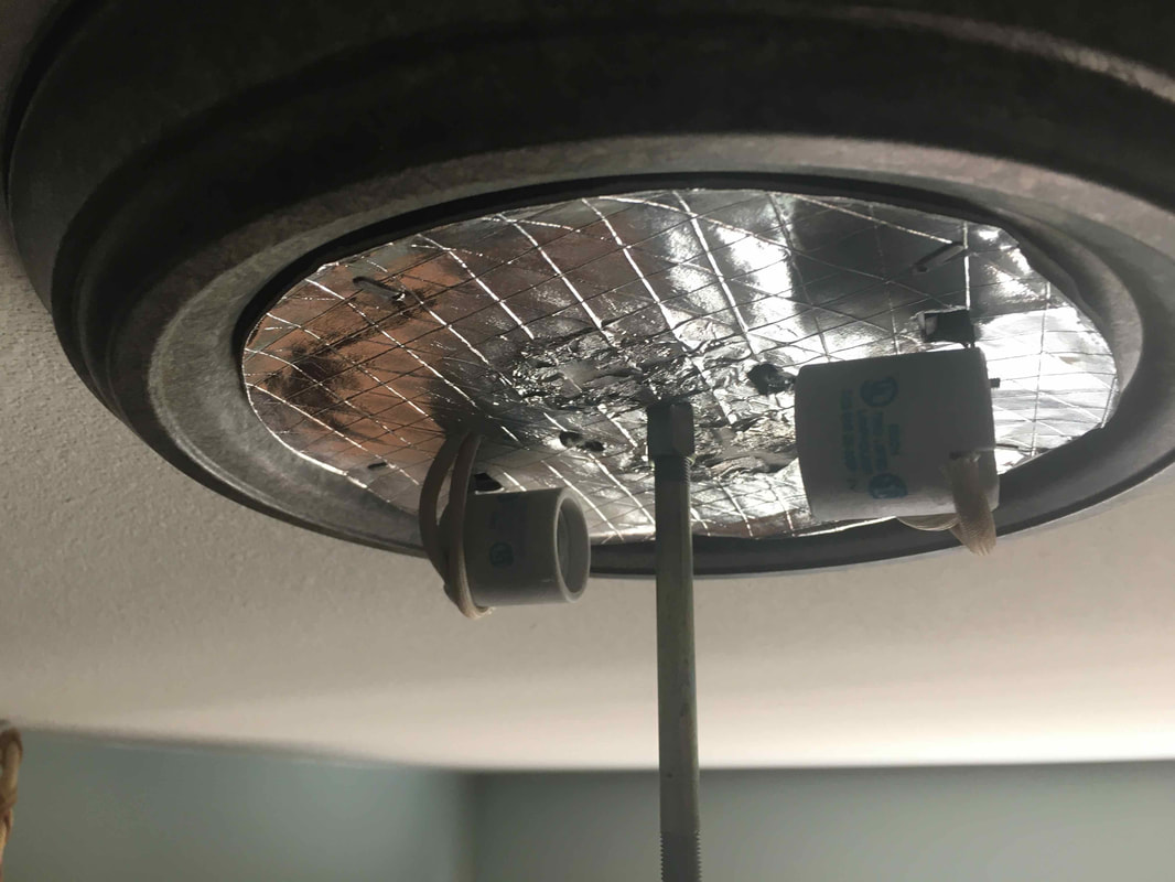 Empty light fixture with bulbs removed.