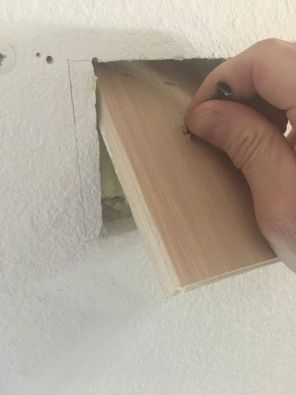 Fitting a backer piece for drywall repair